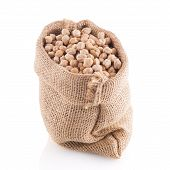 picture of chickpea  - Uncooked chickpeas Uncooked chickpeas on burlap bag on white background - JPG