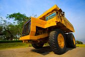 stock photo of mines  - Heavy mining truck in mine and driving along the opencast - JPG