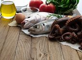 pic of sucker-fish  - Fresh fish and vegetables on wooden table - JPG