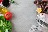 foto of sucker-fish  - Fresh fish and vegetables on wooden table - JPG