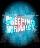 stock photo of creeping  - creeping normalcy word on business digital screen - JPG