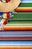 stock photo of maracas  - Mexican background with sombrero straw hat maracas and traditional serape blanket or rug - JPG