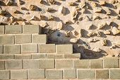 stock photo of rebuilt  - Rebuilt layers of an old wall on an archeological site