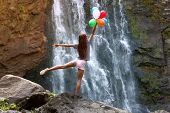 pic of waterfalls  - The young woman with balloons on the background of the waterfall - JPG