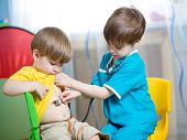 pic of home remedy  - children boys play doctor together at home - JPG