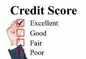 stock photo of performance evaluation  - Credit score evaluation form tick excellent by businessman - JPG