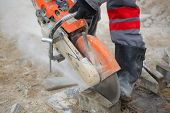 picture of sawing  - cuts concrete tile - JPG