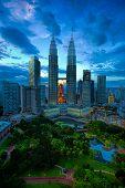 stock photo of petronas towers  - View of Kuala Lumpur skyline at sunset - JPG