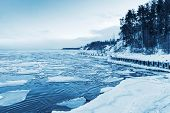 picture of frozen  - Winter coastal landscape with floating ice and frozen pier - JPG