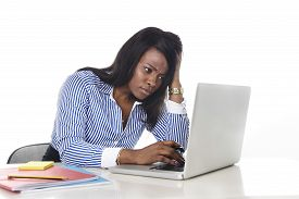 image of secretary  - black African American ethnicity tired and frustrated woman working as secretary in stress at work office desk with computer laptop worried in business frustration concept - JPG