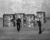 picture of yell  - Manager using speaker yelling at businessman pushing big jigsaw puzzle concrete blocks with gray concrete indoor background - JPG