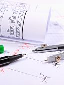 stock photo of drawing  - Rolls of electrical diagrams and accessories for drawing lying on construction drawings drawings and accessories for the projects engineer jobs - JPG