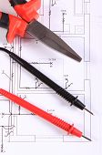 pic of pliers  - Cables of multimeter and metal pliers lying on construction drawings of house electrical drawings and work tools for engineer jobs - JPG