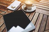 pic of blank check  - Wooden table with empty blank screen tablet cup of cappuccino and bill check with money business work break flare sun - JPG