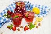 pic of cold drink  - Cold strawberry drink with fresh strawberries and lemon on white wooden background - JPG