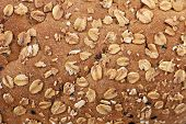 stock photo of whole-wheat  - closeup whole wheat bread skin grain and cereal - JPG
