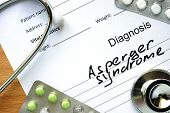 stock photo of aspergers  - Diagnostic form with diagnosis Asperger syndrome and pills - JPG