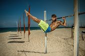 stock photo of pull up  - Closeup of young strong athlete doing pull - JPG