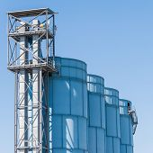 foto of silos  - Detail of chemical plant silos and pipes - JPG