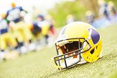 pic of football helmet  - American football helmet lying on field - JPG