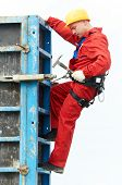 pic of formwork  - construction builder worker joiner working with formwork for concrete pouring at building site  - JPG