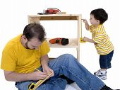 Boy And His Father Building A Storage Cabinet Together poster