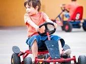 foto of pedal  - Boy child riding happy a pedal cart - JPG