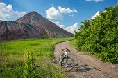 stock photo of slag  - Slagheap  and bikeof ukrainian steppe from height of the birds flight - JPG