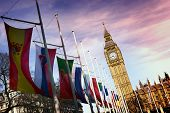 picture of big-ben  - Angled View of Row of International Flags in front of Iconic Big Ben Clock Tower - JPG