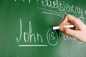 image of grammar  - Teacher hand writing grammar sentences on blackboard background - JPG
