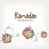 stock photo of ramadan mubarak card  - Elegant greeting card with colorful traditional lanterns on shiny floral design decorated background for Islamic holy month of prayers - JPG