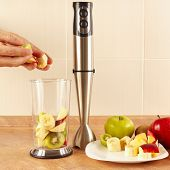 picture of blender  - Hands chefs put the fruit in the blender for cocktails on table - JPG