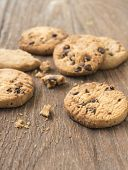stock photo of chocolate-chip  - Cookies chocolate or chocolate chips on a wooden table - JPG