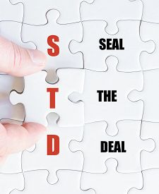picture of std  - Hand of a business man completing the puzzle with the last missing piece - JPG