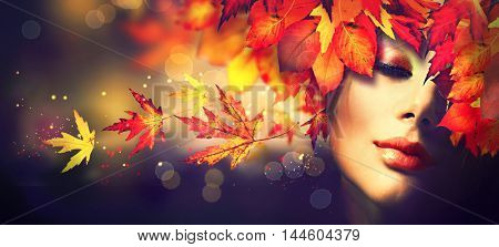 Autumn Woman Fashion Portrait. Fall. Beautiful Model Girl with colourful yellow, red and orange autu