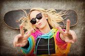 Blond teen skater girl giving peace sign poster