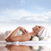 stock photo of beautiful lady  - Young beautiful lady getting spa treatment isolated on white - JPG