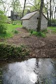 stock photo of slave-house  - spring feed creek and the spring house restored on the grounds of the hermitage