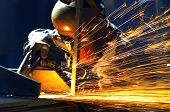 picture of welding  - welder with protective mask welding metal and sparks - JPG