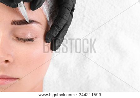 poster of Young Woman Undergoing Eyebrow Correction Procedure In Salon, Top View