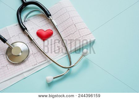 poster of Medical Concept: Stethoscope, Red Heart And Paper Cardiogram Are On A Blue Background With Copy-spac