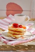 Stack Of Fritters With Strawberries. Pancakes With Red Jam. Finished Fritters On The Background. poster