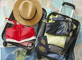 Open Travelers Bag With Clothing, Accessories, And Passport. Travel And Vacations Concept poster