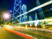 Traffic at city in night,Hongkong. The skyscrapers is one of  landmarks in Hongkong. poster
