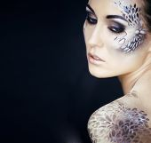 Portrait Of Pretty Young Woman With Creative Make Up Like A Snake, Fashion Victim With Python Skin C poster