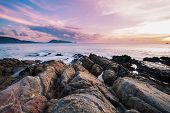 Long Exposure Image Of Dramatic Sky Seascape With Rock In Sunset Scenery Background poster
