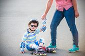 Preschooler Falls Over While Rollerblading With Mother In The Park poster