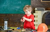 Toddler On Busy Face Plays With Screwdriver Tool At Home In Workshop. Kid Boy Play As Handyman. Chil poster