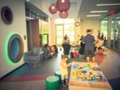 Vintage Blurred Playroom Kid Corner At Public Library In Usa poster