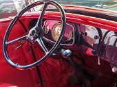 View Of The Red Interior Of A Classic Antique Car, With Steering Wheel And Dashboard, Very Beautiful poster